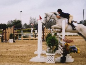 My daughter Sam Kamen on our horse *Elusive Dream* 2004 Reserve Jumper Champion • Ocala H.I.T.S. Circuit